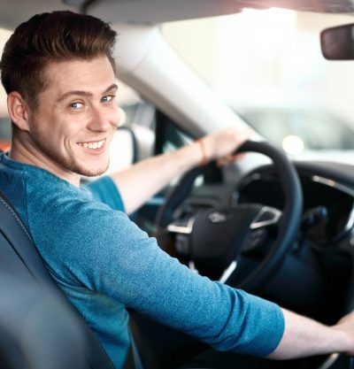 happy-young-male-driver-wheel_136930-4